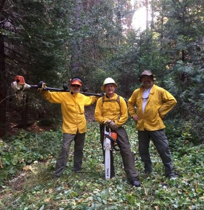 Men with saws photo