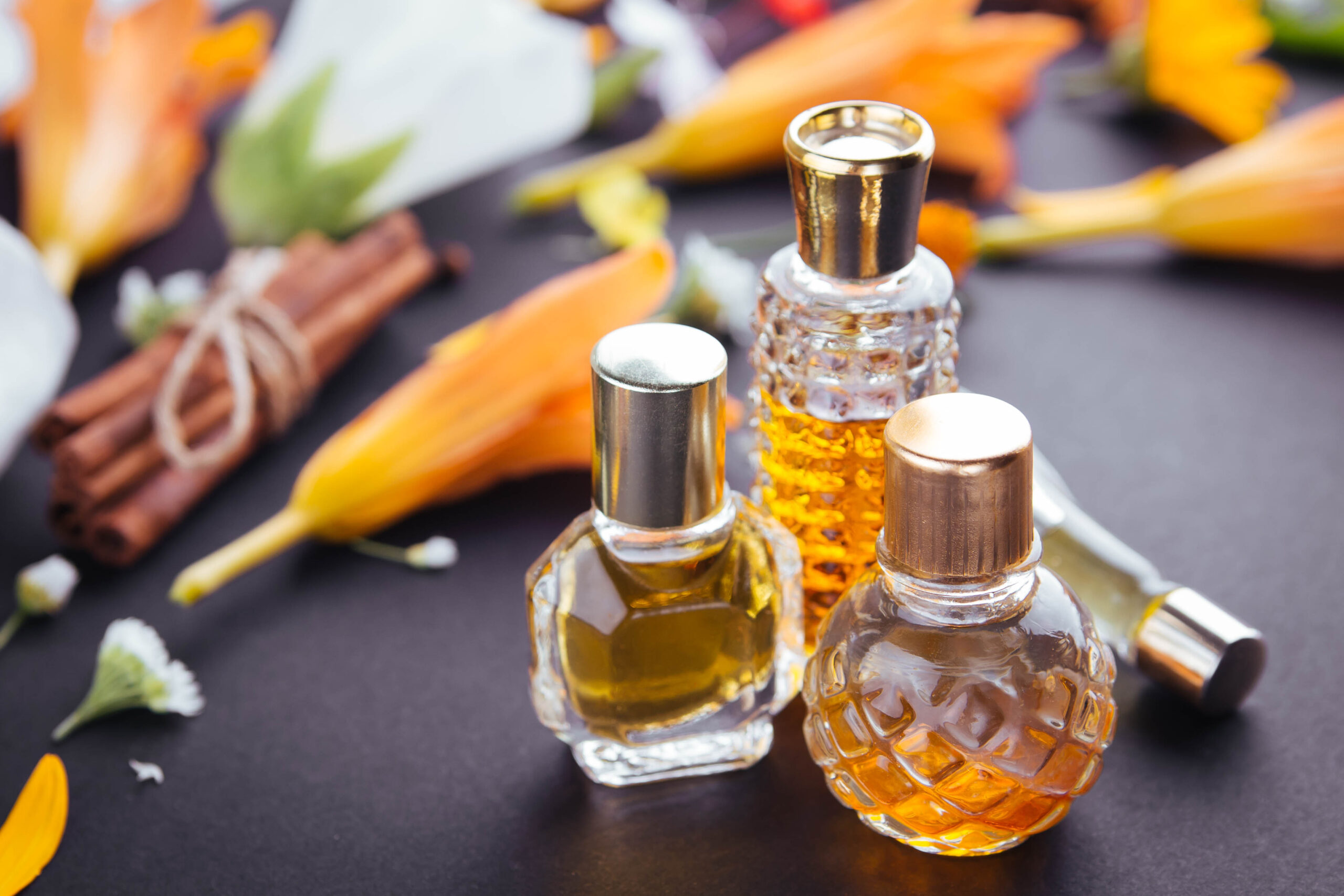 Bottles of perfume with ingredients